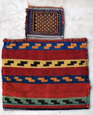 Antique SW Persian Namakdan (salt bag). 44 x 54 cm. Soumak and kilim. Cotton white. Very slight tear to the right of the back kilim. Just a brilliant piece of Art.