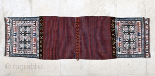 Complete antique Luri/Bakhtiari saddlebags bearing a very clean workmanship, ca 1900-10, 58 x 202 cm (opened along sides)wool sumac on white cotton ground. All natural colors.