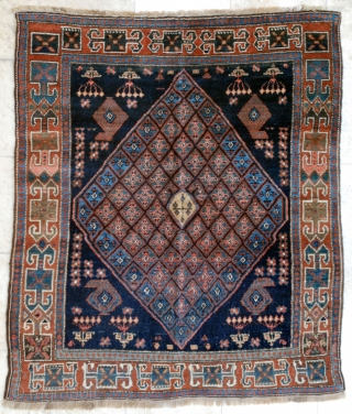 """Sonqor Kurdish with a bold border and quite a tribal character. Ca. 1920, 136 x 160 cm. (4'6"""" x 5'4""""). This rug with its squarish size and concentric design could have been  ..."""