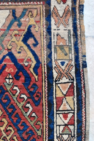 200 x 310 cm. This antique small carpet bear at once primitive and archaic devices that links it to ancient Anatolian rugs on one hand and a medallion that could well be  ...