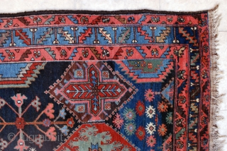 Bakhtiari rug from the village of Harchegan. 140 x 216 cm. Circa 1920-30. All natural colours. Wool weft. Spot of lpw pile. Original upper end, secured lower end.