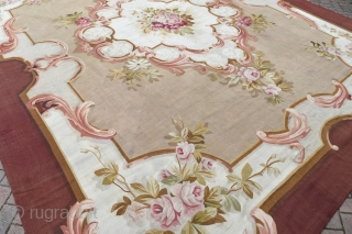 A very large antique French Aubusson carpet. Very decorative piece with soft colours. Unusually good condition, just a few small repairs and slight wear in places. A substantial carpet, professionally backed. Mid  ...
