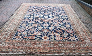 Good antique Ferahan carpet with massive and colourful, all-over Herati design on mid blue ground flanked by soft green borders. Lovely original condition, even low pile throughout, very clean and tidy.  ...