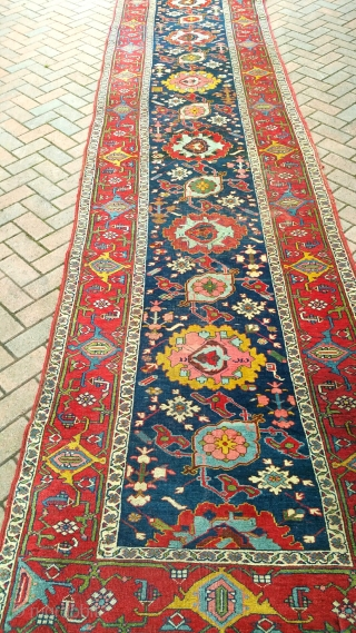 A very large antique Harshang design Bijar runner, mainly in good original condition but with damaged ends. Very heavy! Circa 1880. 18x3'6