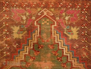 Mudjur Prayer Rug, Late 18th Century. Incredible colors. It contains a solid green field representing the heavens crested with a stunning cloud band. It is worn all over but its design elements  ...