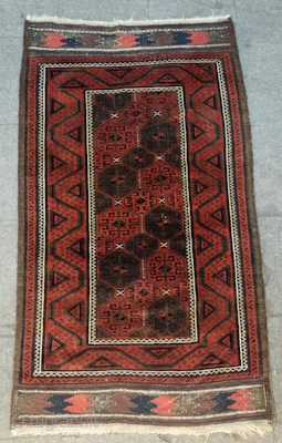 Baluch, Khorasan area, Late 19th to early 20th Century. Possibly Torbat-e Haidari area. Great deep purple and a strong madder red.  Kilim ends fully in tact and in the same palette  ...