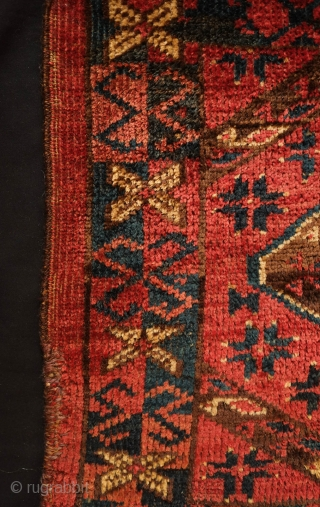 Beshir torba face, 19th century.  Striking large, centrally placed floral motif.  A small area secured along the bottom left selvage.  A solid piece.  43 x 126 cm