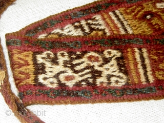Complete Pre-Columbian sash or band, Andean, camelid fiber, currently presented in a frame, with bird figures throughout.   Please ask for additional photos.
