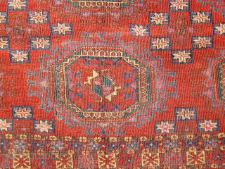 """First half of the 19th Century (earlier?) Tekke chuval with 6 Salor guls.  Extremely finely knotted.  Profuse use of silk.  Asymmetrically knotted, open to the right.  48"""" by  ..."""