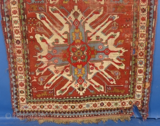 """ANTIQUE EAGLE KAZAK, SIGNED(?), USED AND WORN, 100"""" x 50"""".  This is/was a nice Eagle Kazak. It is worn and has a serious corner tear and a 2-3"""" hole. There is wear in many areas  ..."""