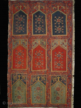 Ushak region carpet fragment of a large mosque prayer carpet with three rows of three prayer niches, late 18th century, 400cm high and 245cm wide. Condition: good overall even pile.