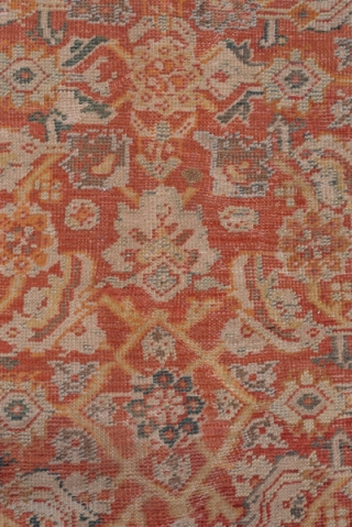 Mahal Carpet  10.4 x 14.2 3.16 x 4.32   A fairly l.arge scale allover Herati 'fish' leaf, open diamond, rosette and palmette pattern in light straw ans ivory decorates the warm madder red field of  ...
