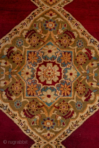 Amritsar Square Carpet  12.2 x 12.4 3.71 x 3.77 The deep wine brown semi-open field shows a pole medallion of three conjoint lozenges with matching side triangle fillers. Giant and lesser botehs  decorate the  ...