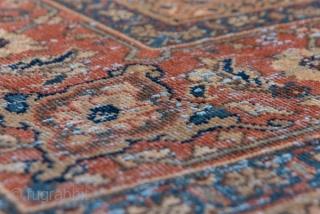 Mahal Carpet  8.9 x 12.0 2.71 x 3.65  A classic small pattern Persian allover Herati pattern fills the medium bark brown field of this west Iranian village carpet. The caramel tone main border shows simple  ...