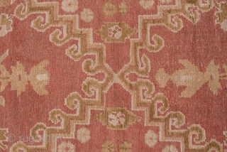 Oushak Carpet  11.10 x 14.6 3.38 x 4.45  This boldly drawn workshop carpet  shows a soft coral field with two strongly hooked side-by-side stepped cartouches , each on a vertical pole, with vases sprouting  ...