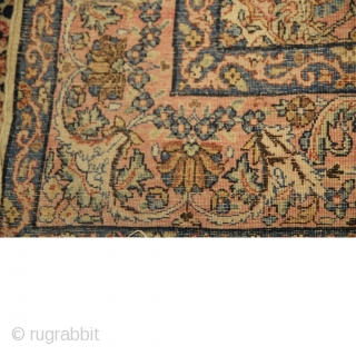 Antique Kirman Carpet Size: 290cm x 178cm Handwoven Antique Kirman Carpet, delicate blossoming medallion of flowers heads and sprays on a white ivory field. Pink corner spandrels encased in a delicate pink and blue  ...