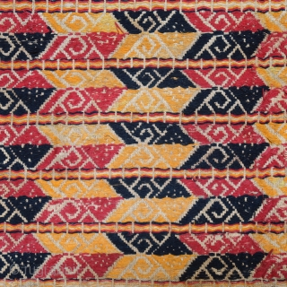 Indonesia | Antique ceremonial weaving tampan   Indonesia, Sumatra, Lampung, c. 1900   Handspun cotton base, supplementary weft weaving, botanical dyes, gold-wrapped thread    A large, festive tampan with a colourful geometric design of  ...