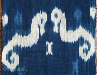 Sumba | indigo ikat men's headcloth | Indonesia  East Sumba, Kanatang, 2nd half of 20th century  Commercial cotton, natural indigo dye, warp ikat  A headcloth (tiara) woven with large white ikat figures on an indigo  ...