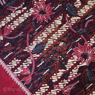 Java | Mid 20th C Hand-Drawn Batik Head Cloth (Iket Kepala)  Indonesia Java, Banyumas, mid 20th century  Commercial cotton and dyes, hand-drawn batik (tulis)  A dramatic ceremonial square that contrasts the cherry red square diamond  ...