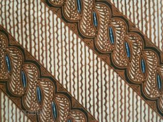 Java   early hand drawn batik waist wrapper  Indonesia, Java, Solo, second quarter of 20th century  Commercial cotton, botanical indigo and soga dyes, batik tulis (hand drawn batik)  A graceful, sophisticated batik, hand-drawn in the  ...