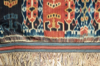 Sumba Ikat Men's Mantle with Red Dye (Hinggi Kombu)   Origin: Indonesia, East Sumba, 1970-1990  Technique: Handspun cotton, commercial dyes, warp ikat, twining  Description: A modern example of one of the oldest ikat patterns for  ...