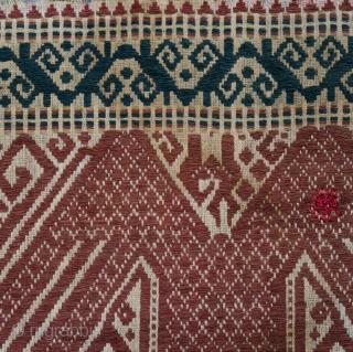 Indonesia   Antique ceremonial weaving tampan   Indonesia, Sumatra, Lampung, Komering, Paminggir people, c. 1900   Handspun cotton base, supplementary weft weaving, botanical dyes    A large tampan with an imposing design executed in  ...
