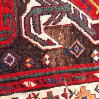 Fine mid-nineteenth century Lenkoran fragment. The colours are particularly good in this piece, generally full pile, but patched, and the brown field is corroded. 48in by 37in