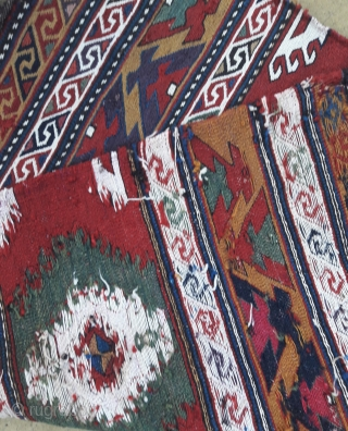 Pair of early 20th century Caucasian mafrash end panels, stunning saturated colours, and very fine weave. Quality items, each 22in by 20in Small ares of reweave (see detail pics)
