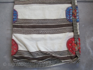 """Large Karapinar Cargo/ Storage bag....Central Anatolia...first half 20th C... excellent condition as shown...2'7"""" x 5'2"""" (80cm x 160cm )...all un-dyed wool... a tight balanced plain-weave ground with extra-weft patterning , felt'grips' w/ embroidery and  ..."""