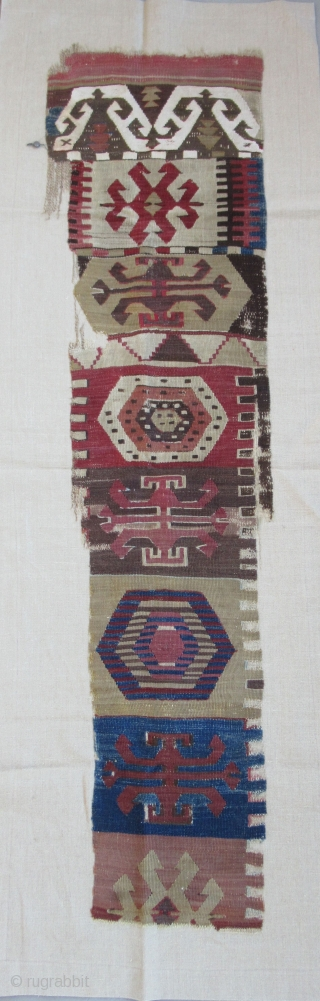 "Anatolian kilim border fragment....Southeast Anatolia ( Reyhanli ? Kurdish ?) before 1825....wool w/ cotton-ground end-panel...very fine weave....frag. size 1'4"" x 5""( 40 x 155 cm) ....unusual archaic motif drawings...professionally mounted on linen....condition  ..."