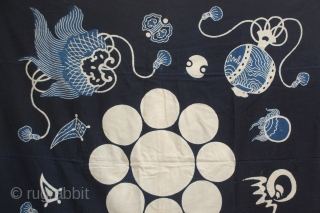 A wonderful large Tsutsugaki Furoshiki indigo dyed hand-spun cotton printed design of a family crest.  This is an old furoshiki, a square-shaped cloth that was used all over Japan for wrapping, hauling  ...