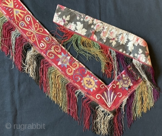 An exceptional antique Uzbek Lakai Tribe silk embroidered 'saygosha' hanging, dating to 19th century. These 'v' shaped hangings were dowry textiles, initially made to attach to the elegant and decorative bridal bed  ...