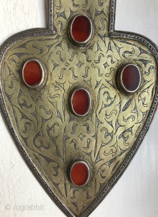 An Excellent  Antique Turkoman / Turkmen silver pendant with gold painted and fired and carnelian inset. These heart shaped pendants (worn in a necklace ) are known as 'Asyk' and this  ...