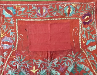 A lovely antique Uzbek Lakai silk embroidered horse blanket / saddle cover. This lovely ethnographic embroidery dates to the late 19th century and is polychrome silk chain stitched embroidery on red wool  ...