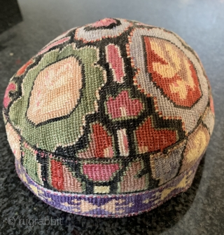 A beautiful antique Uzbek silk Iroqi stitched embroidered hat from Shahrisabz region. Dating to the late 19th century this rare hat is made of a form of cross stitched associated with the  ...
