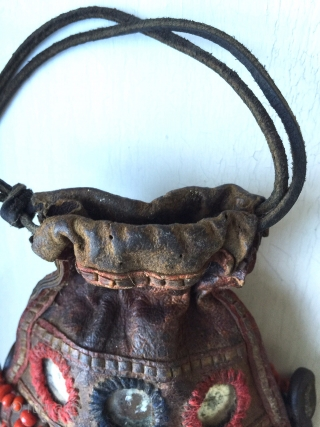A very rare antique Beaded leather bag from Tibet or Ladakh India. Dating to the 19th century, such bags were part of the Buddhist traditions of the Hamaliyan people. The blood red  ...