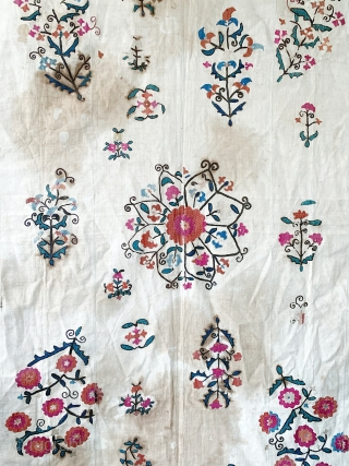 A beautiful antique Uzbek Nurata silk embroidered suzani / susani , dating to the last 19th Century. It is relatively large piece with flat stitched (basma stitched) silk embroidery on a cotton  ...
