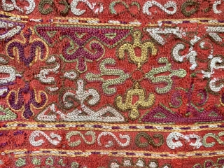 An exceptional antique Turkoman Turkmen Chodor tribe silk embroidered sleeve (opened) dating to the19th century. Chodor silk needlework were often done on red bannat trade cloth and were some of the finest  ...