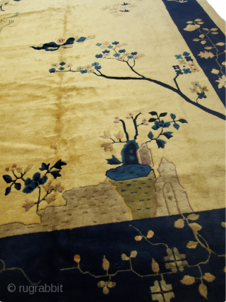 Lovely and unique beige and navy Chinese carpet