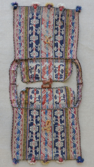Set of Aymara cargo bags, (alforjas), Bolivia.  Early 19th century or before.  Placed over the head and draping front and back from the shoulders, these double bags are said to  ...