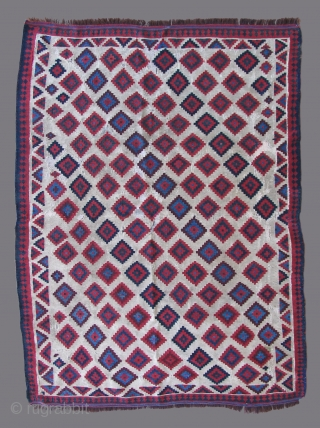 This flat weave is probably from the Veramin area of Northern Iran. Possibly Afshar? It is as old or older than any I've seen. It was repaired many years ago, somewhat brutishly  ...