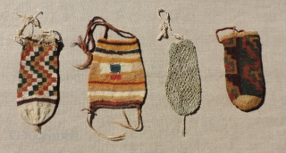 Group of four small Pre-Columbian pouches.  B.C. 100 - A.D. 400.  Size: Largest is 7.5 inches tall.  Sold as a group or individually.  Reasonable.