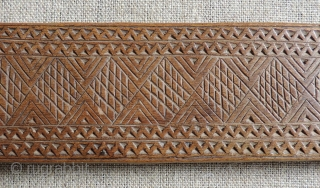Albanian distaffs and other carved wooden weaving implements.  19th century. longest piece 37 x 4 inches.