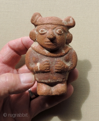 Pre-Columbian Mochi Ceramic Figure.  A.D. 100 - 800.  Rare, small guardian figure with immense charisma and charm. There is something very special about this little being.  Traces of the  ...