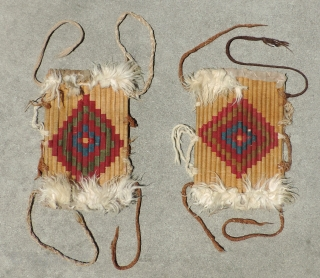 Pair Of Incan Warrior's Shin Protectors. Rare and unusual shin guards made with reeds wrapped by camelid fiber yarns in a stepped diamond pattern and trimmed top and bottom with applied alpaca  ...