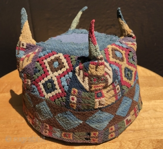 Highly unusual Andean four-cornered hat.  A.D. 500 - 900.  This hat is made with open-work panels on four sides.  At first glance it appears to be a Tiwanaku-type hat  ...