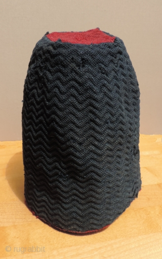 Pre-Columbian knotted headdress, Arica, Faze Cabuza, Tiwanaku period - A.D. 300 - 1,100.  This is an unusually small (miniature-like) hat with ribbed chevron pattern.  It is a rare type of  ...