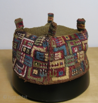 """Andean pile headdress.  Wari culture (500 - 800 AD).  This is an excellent """"four cornered hat"""" with interlocked caiman-like depictions. Black Caiman are the largest predators in South America. They  ..."""
