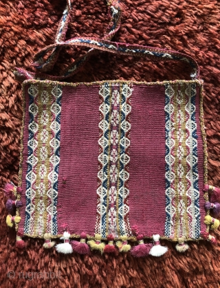 Three Andean coca bags woven by the indigenous Aymara people. The Aymara are a pastoral group of indians that live in the high Altiplano region of Bolivia at about 12,500 feet above  ...