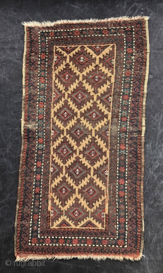 Nice little 19th century Baluch balisht.  Camel hair field. Size:39 x 20 inches.